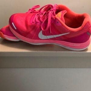 A woman's Nike sneakers